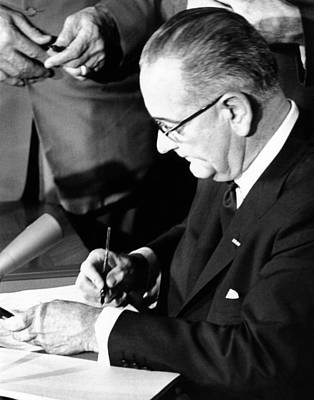 Lyndon Photograph - President Lyndon Johnson Signing by Everett