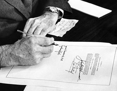 Lyndon Photograph - President Lyndon Johnson Signs A $102 by Everett