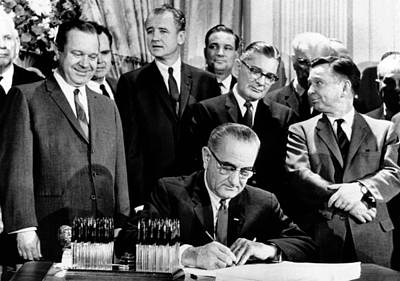 Lyndon Photograph - President Lyndon Johnson Signs A $11.5 by Everett