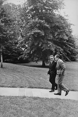 President Nixon Walking With Kissinger Art Print by Everett