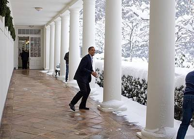 President Obama In A Snowball Fight Print by Everett
