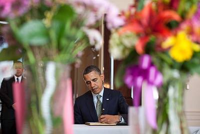 President Obama Signs A Condolence Book Art Print by Everett