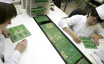 Printed Circuit Board Assembly Work Art Print by Ria Novosti