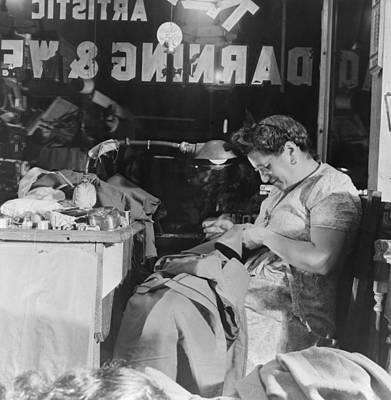Window Signs Photograph - Proprietress Of A Jewish Weaving Shop by Everett