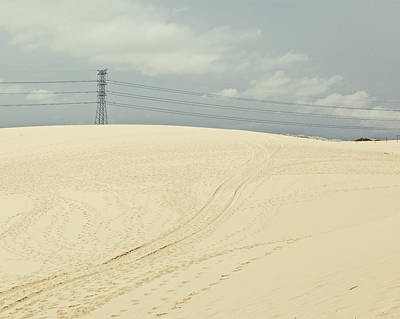 Pylon Atop Sand Dune Art Print by Photograph by Chris Round