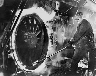 Metal Tires Photograph - Railroad Worker Sweating A Tire by Everett