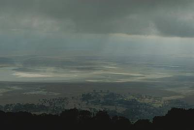 Dry Lake Photograph - Rain Clouds Over The Ngorongoro Crater by Kenneth Garrett