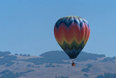 Photograph - Rainbow Balloon Over Hills by Bonnie Muir