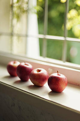 Lodi Photograph - Red Apples In Line On White Wooden A Windowsill by Les Hirondelles Photography