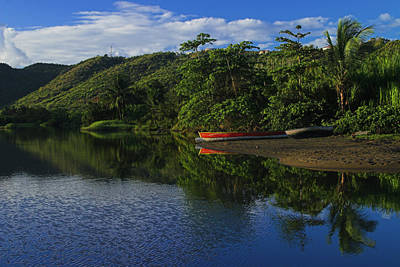 Red Canoe On Roseau River- St Lucia Art Print by Chester Williams