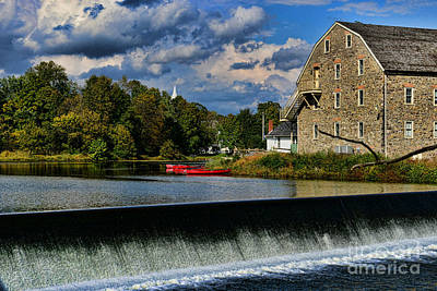 Canoe Waterfall Photograph - Red Canoes At The Boathouse by Paul Ward