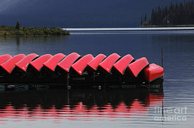 Red Canoe Photograph - Red Canoes Maligne Lake by Bob Christopher