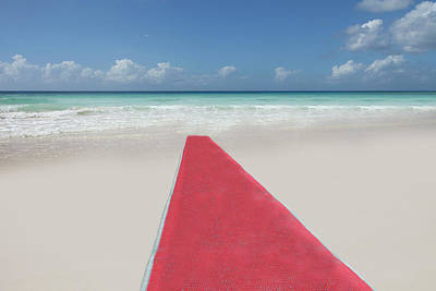 Red Sky Photograph - Red Carpet On A Beach by Buena Vista Images