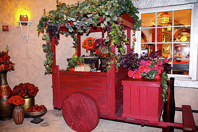 Photograph - Red Cart Of Flowers by Terry Wallace