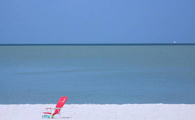 Photograph - Red Chair And Sailboat by Bill Lucas