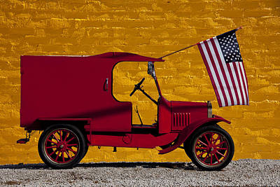 Red Truck Against Yellow Wall Art Print by Garry Gay