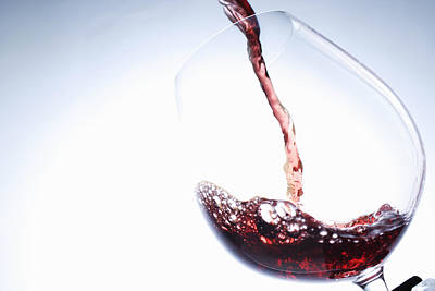 Pouring Wine Photograph - Red Wine Pouring Into Glass by Brett Stevens