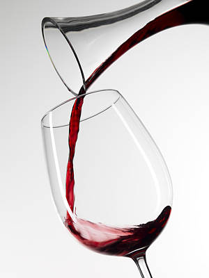 Pouring Wine Photograph - Red Wine Pouring Into Glass From Decanter by Roger Méndez Fotografo, S.L.