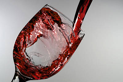 Red Wine Splashing From A Glass Cup Art Print by Paul Ge
