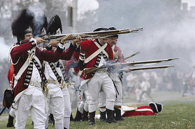 Redcoats Shoot Muskets In A Reenactment Print by Ira Block