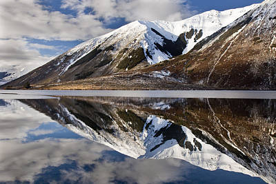 Reflection In Lake Pearson, Castle Hill Art Print by Colin Monteath