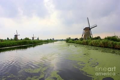 Reflection Of Sky At Kinderdijk Art Print by Carol Groenen