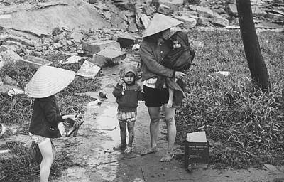 Woman And Baby Photograph - Returning Refugees by Terry Fincher