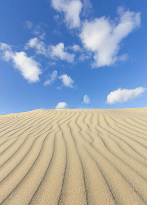 Rippled Sand Dune And Blue Sky With Clouds Art Print by Rob Kints