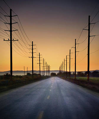 Road And Power Lines At Sunset Art Print by Www.jodymillerphoto.com
