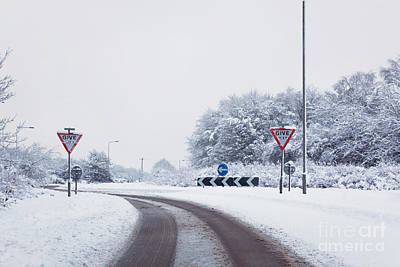Carriageway Photograph - Road With Give Way Signs In The Snow by Richard Thomas