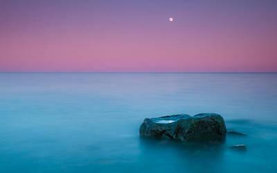 Rock At Coast With Rising Moon Art Print