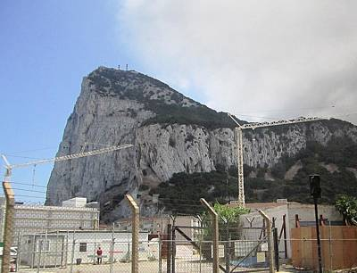 Photograph - Rock Of Gibraltar Construction Cranes Uk by John Shiron