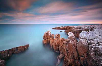 Rocks In Sea At Sunset Art Print
