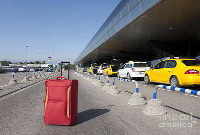 Rolling Luggage Outside An Airport Terminal Art Print by Jaak Nilson
