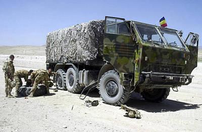 Romania Army Soldiers Repair A Flat Art Print by Stocktrek Images