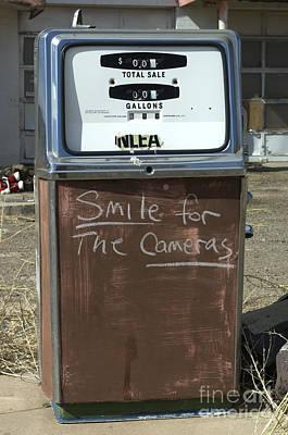 Wurlitzer Photograph - Route 66 Gas Pump Humor by Bob Christopher