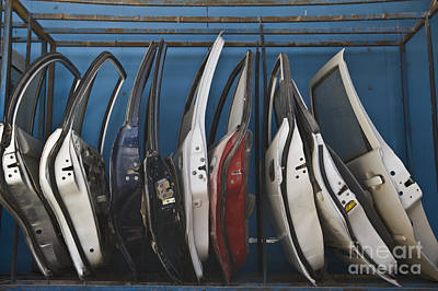 Row Of Dismantled Car Doors Art Print by Noam Armonn