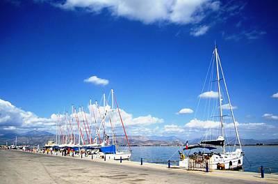 Photograph - Row Of Sailing Boats In The Beautiful Nafplion Bay Water Edge Marina In Greece by John Shiron