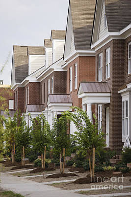 Rows Of New Townhomes Art Print by Roberto Westbrook