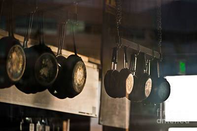 Dogpatch Photograph - Rows Of Pans Hanging In Kitchen by Eddy Joaquim