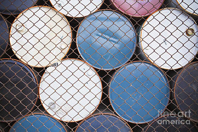 Rows Of Stacked Barrels Behind A Fence Art Print by Paul Edmondson
