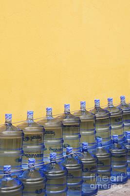 Rows Of Water Jugs Art Print by Jeremy Woodhouse