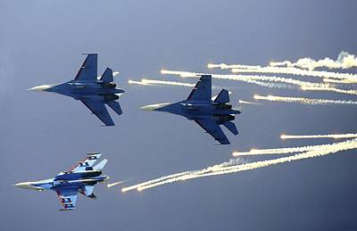 Smoke Trails Photograph - Russian Knights Aerobatic Team by Ria Novosti