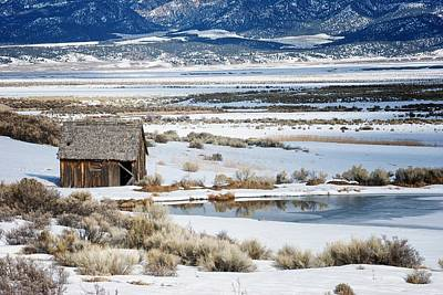 Rustic Barn In A Snowy Valley Next To A Pond Art Print by C Thomas Willard