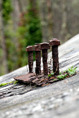 Photograph - Rusty Bolts Atop A Bunker by Marie Jamieson