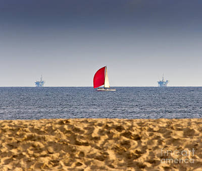 Sailboat And Oil Rigs On The Ocean Art Print