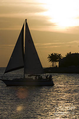 Sun Photograph - Sailboat In Key West At Sunset by Christopher Purcell