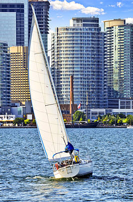 Sports Royalty-Free and Rights-Managed Images - Sailboat in Toronto harbor by Elena Elisseeva