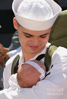 Sailors Girl Photograph - Sailor Holds His Baby Daughter by Stocktrek Images