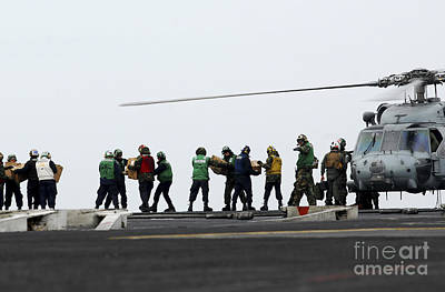 Sailors And Marines Load Supplies Onto Art Print by Stocktrek Images